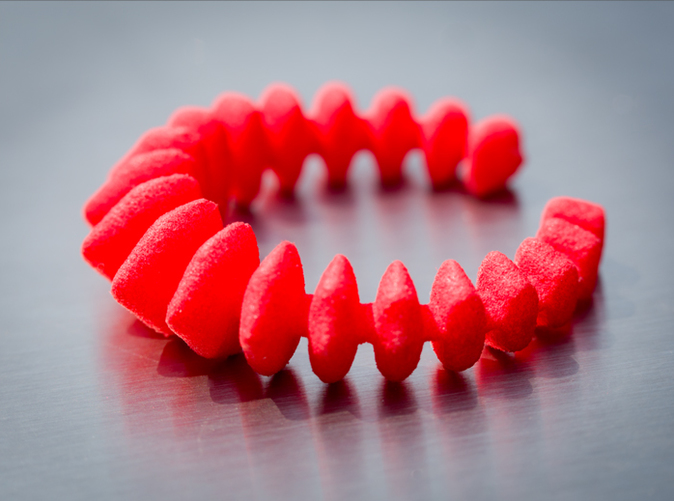 Stegosaurus Ring - Coral Red - Photo