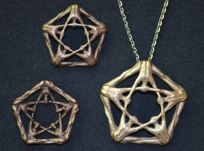Large pentamen pendant beside smaller versions