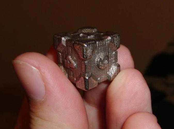 The Cube printed in Steel. Makes for rather heavy, but solid dice.