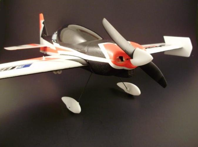 The Sbach shown here with the Wheel Pants and Spinner. (Plane an Spinner Not Included)