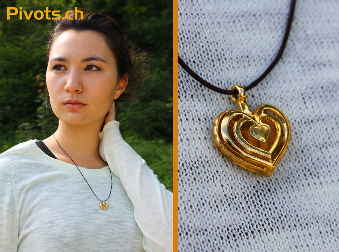 Model wearing our heart pendant