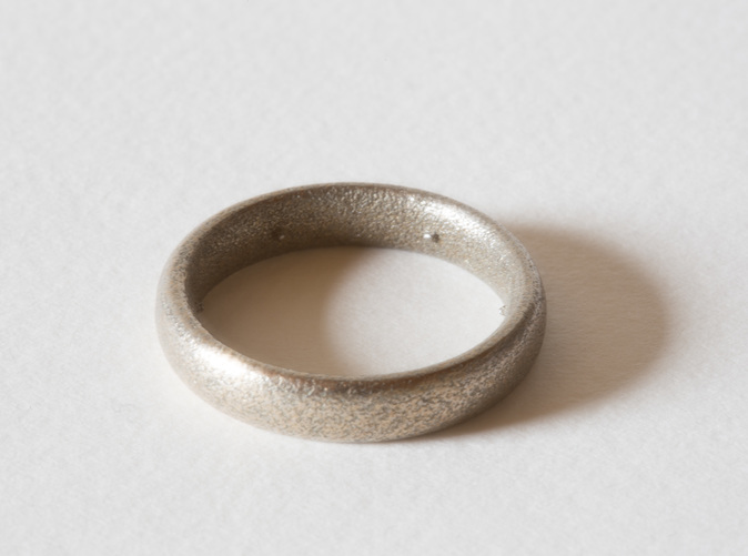 The Max Pain Ring, 3D printed in stainless steel.