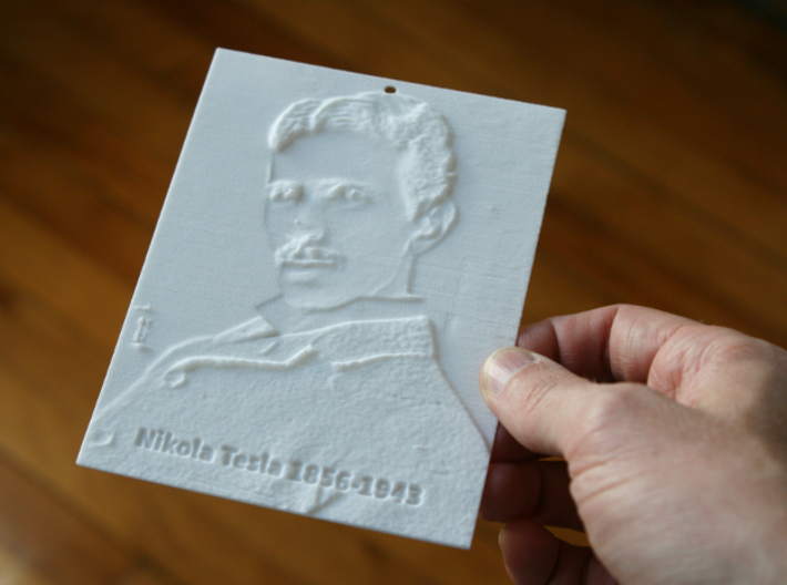 Nikola Tesla Shadowgram 3d printed Photo of the print lit from the front, revealing the relief