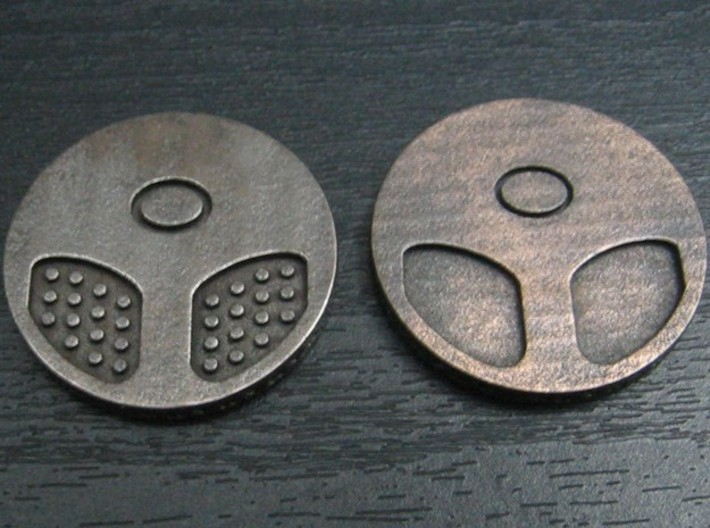 Panda coin 3d printed This version (on left) vs. unpatterned. Note loss of black in recesses. Also applies to front, to a lesser extent.