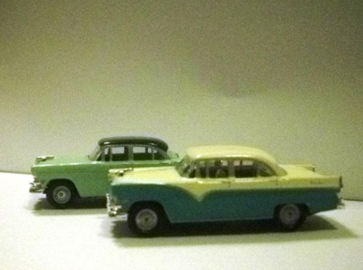 55 FORD WHEEL 3d printed Foreground: Town Sedan with full wheel covers. Behind is customline with CMW wheels.