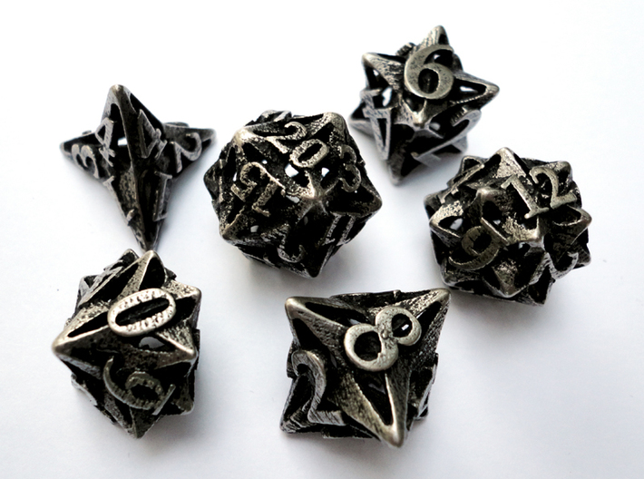 Pinwheel Dice Set 3d printed In stainless steel and inked.