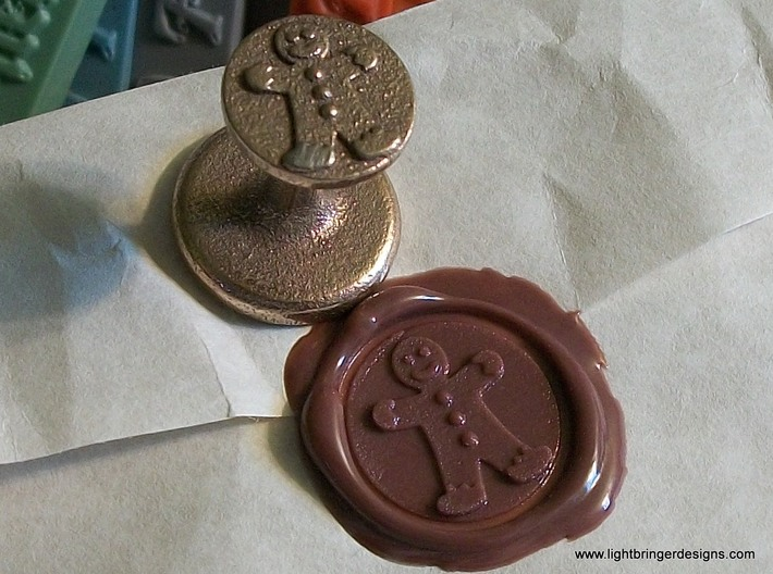 Gingerbread Man Wax Seal 3d printed Gingerbread Man Wax Seal in Stainless Steel, with the impression in Gingerbread Brown sealing wax close up