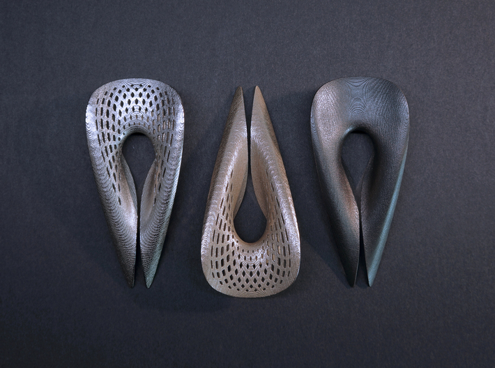 Zisch... Bottle Opener with perforated pattern 3d printed from left to right: Polished Nickel, Stainless Steel, Matte Black Steel