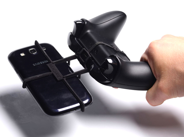 Xbox One controller & Motorola Moto X Force - Fron 3d printed In hand - A Samsung Galaxy S3 and a black Xbox One controller