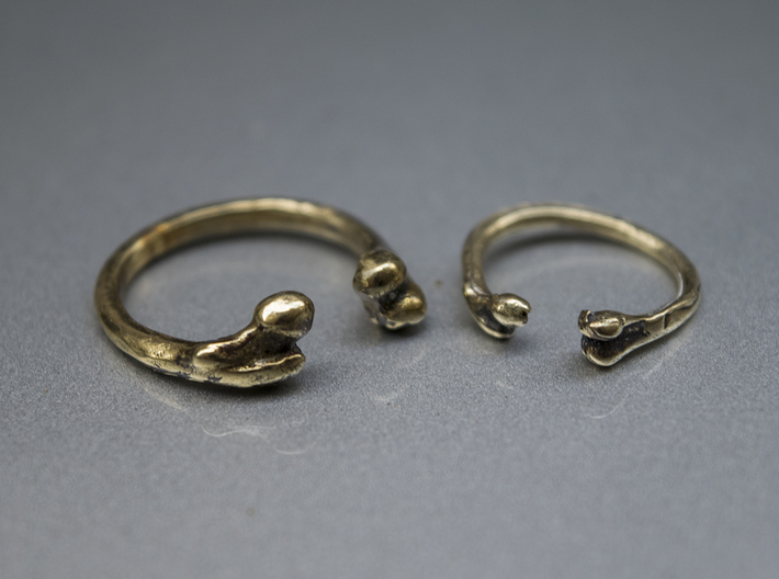 Bone adjustable Ring (Woman size) 3d printed Male (http://shpws.me/LIMM)  and female bone ring in brass
