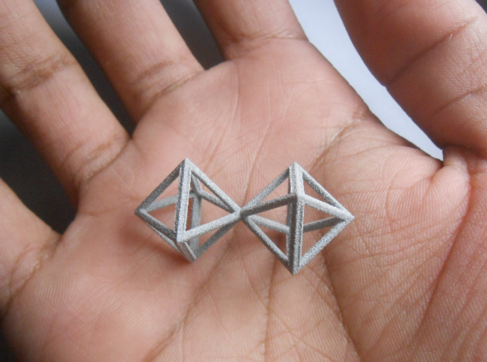 Faceted Twin Octahedron Frame Pendant Small 3d printed Twin Octahedron, held in palm of hand.