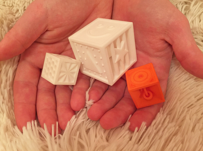 ONE Shape And Texture Dice 3d printed a photo comparing 3 of our dice...