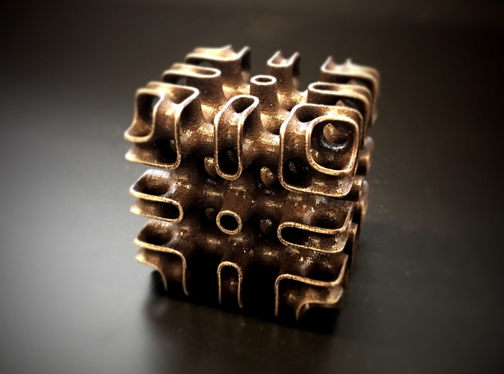 Minimal-Surface Array 3d printed Photo of the Array printed in Bronzed Steel