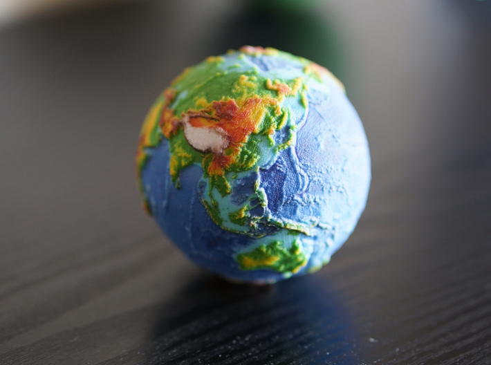 Topographic Earth relief globe 3d printed (picture of a 70mm globe)