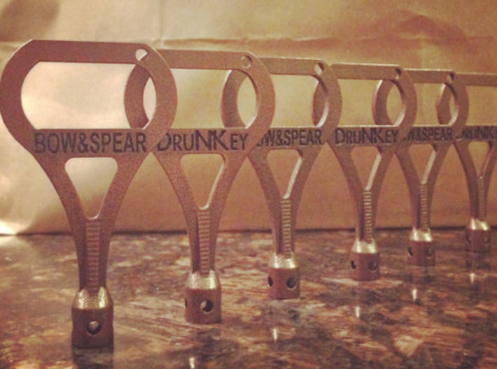 DruNKey v2.0 - A Drum Key Bottle Opener 3d printed Polished Bronze!