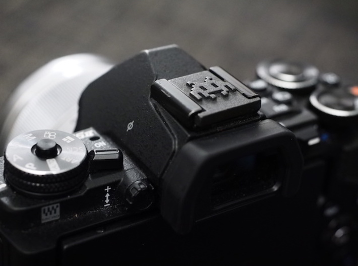 Hot Shoe Cover for Cameras, with Space Invaders 3d printed Perfect fit and great looks on a black Olympus E-M5ii