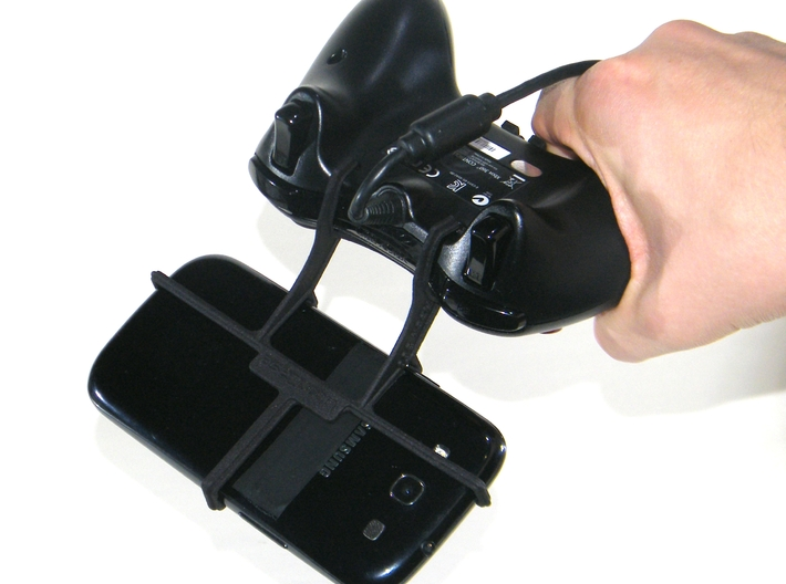Xbox 360 controller & Panasonic Eluga L 4G - Front 3d printed In hand - A Samsung Galaxy S3 and a black Xbox 360 controller
