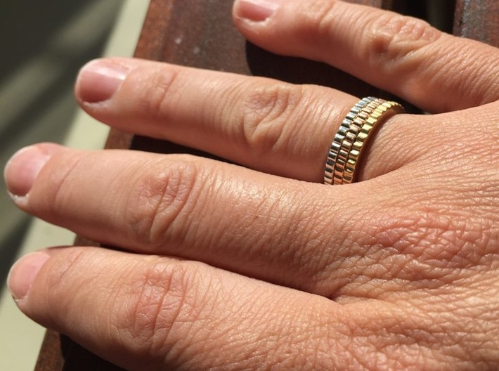 Ingranaggi Ring S/M 17mm 3d printed Only for Photo purposes 3 rings are shown: 3 gold Plated