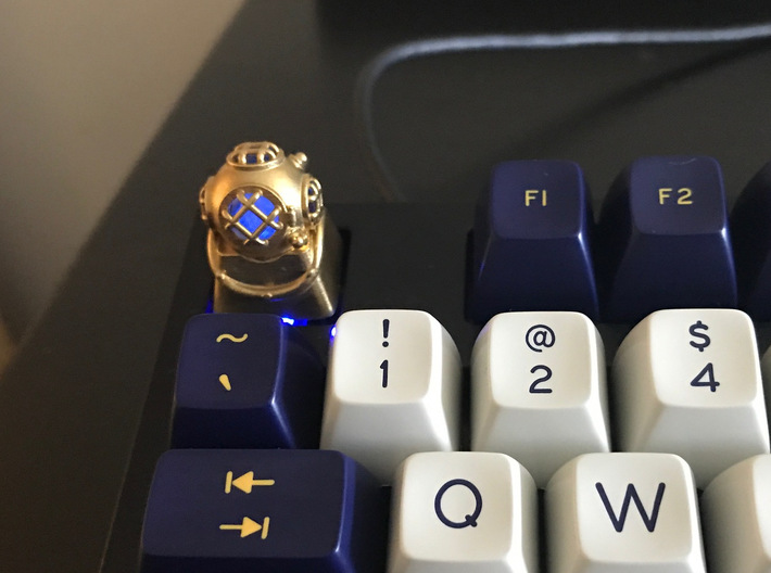 Diver Helmet (For Cherry MX Keycap) 3d printed The diver helmet in polished brass with the frosted skull lit up blue inside