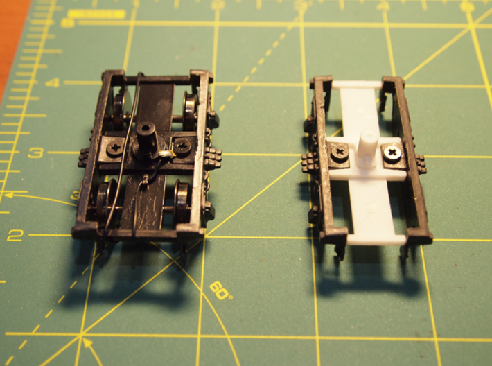 On30-to-On2 Passenger Truck Piece 3d printed The original On30 part vs. the offered On2 part.  On30 is black, On2 is white.