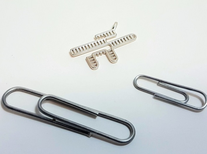 CRISPR RNA Pendant with Bail 3d printed Size comparison between two paper clips and the polished silver pendant