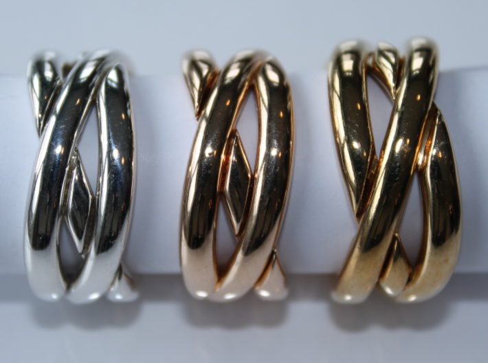 Three Phase Puzzle Ring 3d printed Interlocking Silver, Bronze, and Brass in the solved state.