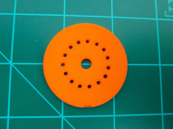 "LED Mounting Disc - 1:350 Alternative Part 3d printed Printed part in ""Strong and Flexible"" orange polished plastic."