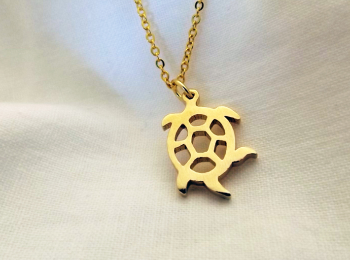 Squirmy Turtle™ Charm 3d printed Squirmy Turtle Charm in Raw Brass