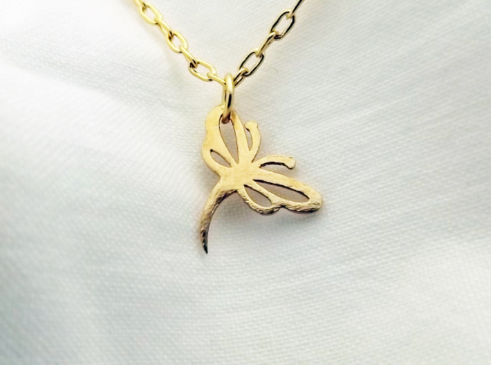 Buzzing Dragonfly™ Charm 3d printed This is the Buzzing Dragonfly Charm in Raw Brass.