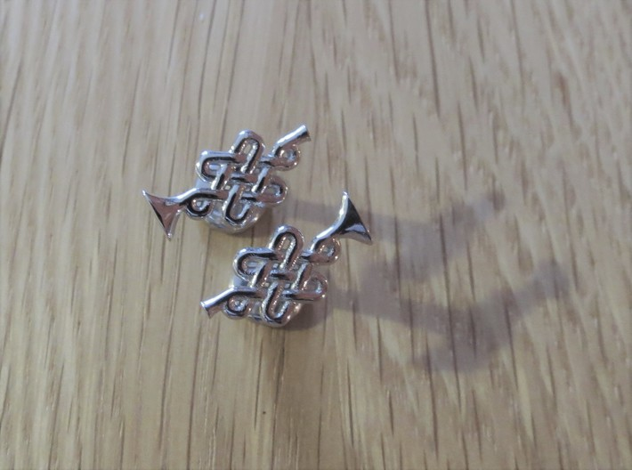 Infinity Knot Trumpet Cufflinks 3d printed Turns out a cool, light silver colour.