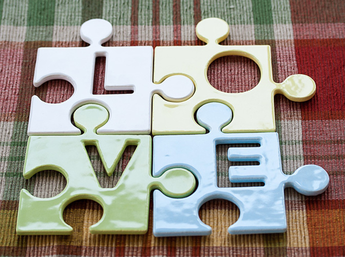 """Puzzle Piece V - """"Love-letters"""" 3d printed 4 puzzle pieces combined to write the word """"love""""."""