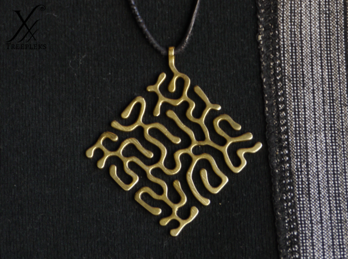 Reacting pendant 3d printed Printed in raw Brass.