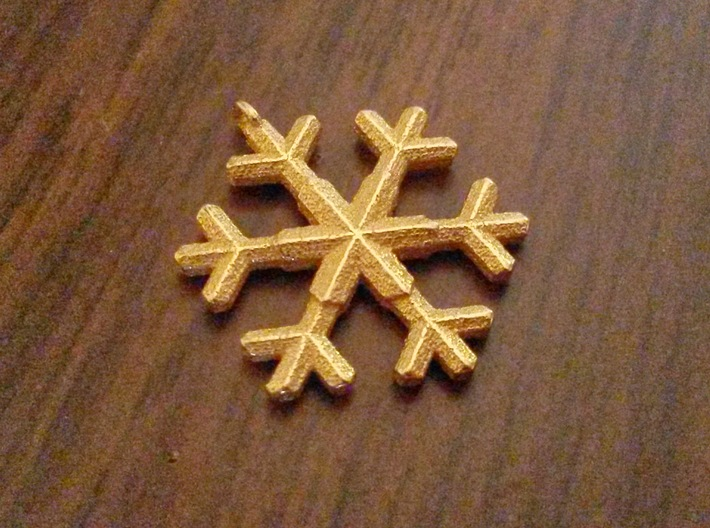 A wee snowflake pendant 3d printed Snowflake in polished gold steel