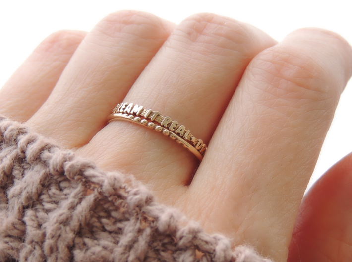 'Dream It Real' Ring (Multiple Sizes) 3d printed 'Dream It Real' and Tri-twist Bead Ring in Polished Bronze