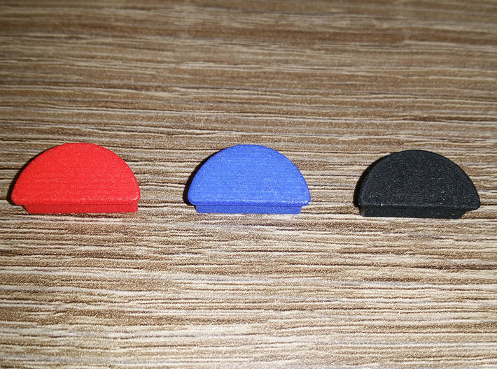 M&P Shield Grip Plug 3d printed Red, blue, and black.