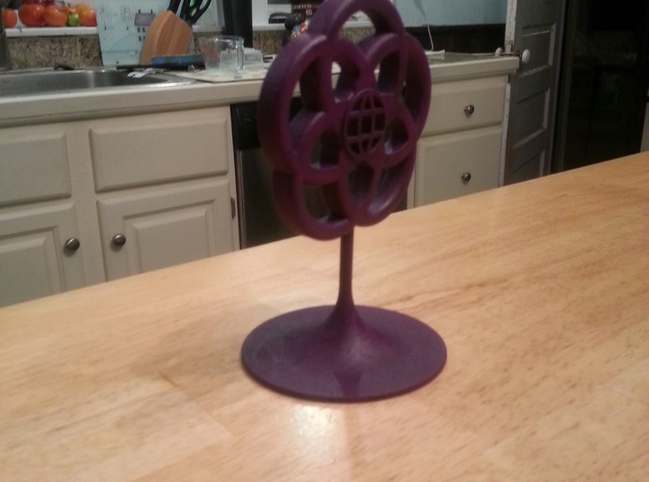 Epcot Logo Cake Topper 3d printed Printed in White, Painted Purple with Acrylic Paint