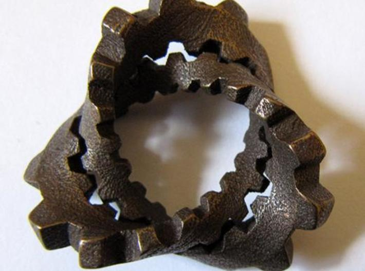 """Trefoil with Cogs 3d printed Stainless steel with """"antique bronze glossy"""" finish."""