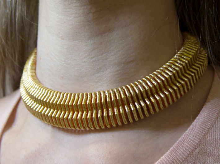 Wide Profile Spring 3d printed Use as a part of a necklace. With imitation leaf gold.