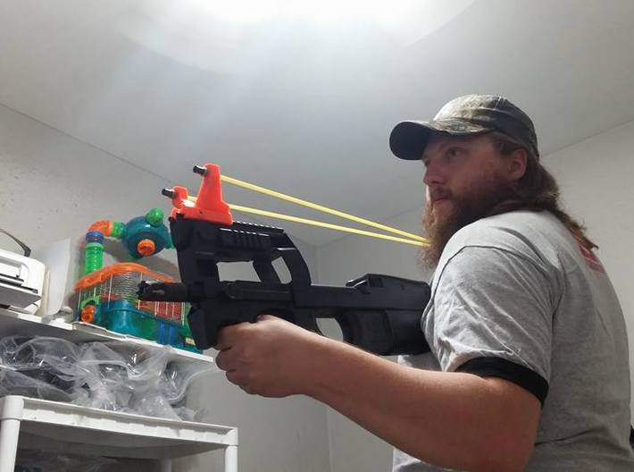 Picatinny-Mounted Sling Bow System Base Kit 3d printed Mounted on Airsoft P90 for demonstration. (Should go on side rail of rifle if possible)
