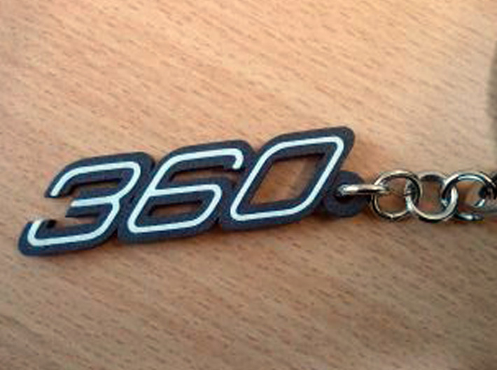 KEYCHAIN 360 3d printed Keychain 360 logo in Black Matte Steel with white plastic inserts.