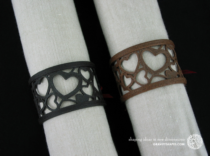 Set of 4 large napkin rings with Hearts 3d printed The photo shows an own print (FDM print) made of brown/black wood incl. decorative lacing.
