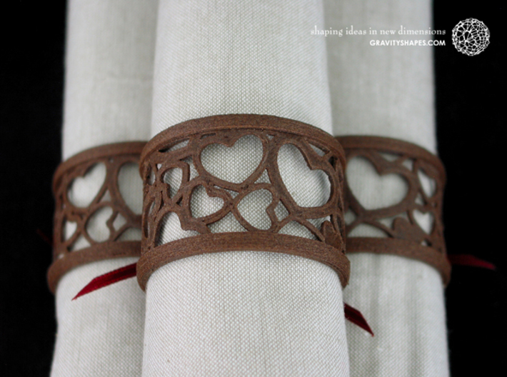 Set of 4 large napkin rings with Hearts 3d printed The photo shows an own print (FDM print) made of brown wood incl. decorative lacing.