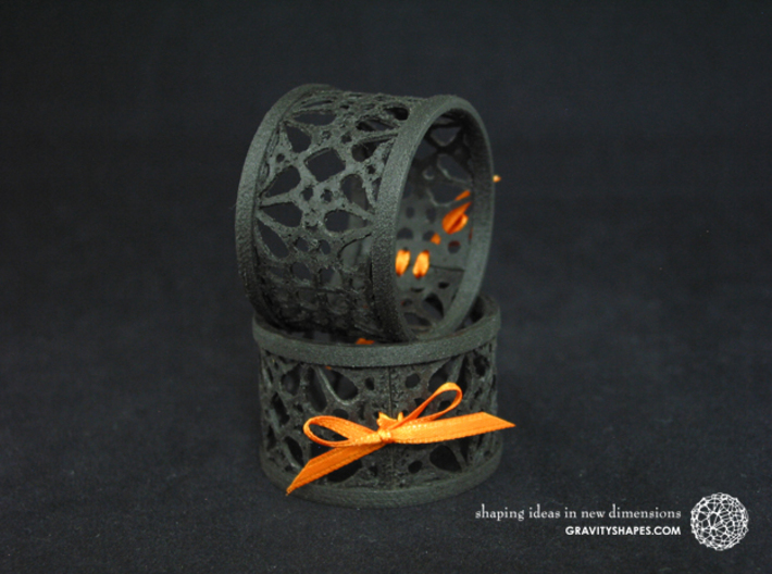 Set of 2 large napkin rings with Mosaic-3a 3d printed The photo shows an own print (FDM print) made of black wood incl. decorative lacing.