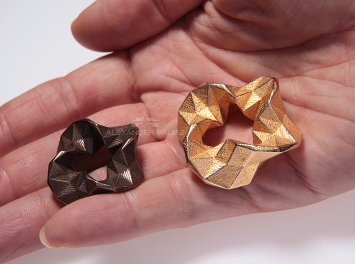Impulse - Small 3d printed Left: Small size in polished bronze steel. Right: Large size in polished gold steel.