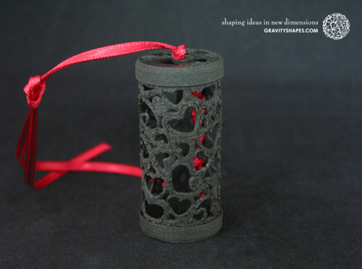 Filigree Gift roll small with Hearts (6 cm) 3d printed The photo shows an own print (FDM print) from a very similar roll made of black wood incl. decorative lacing.