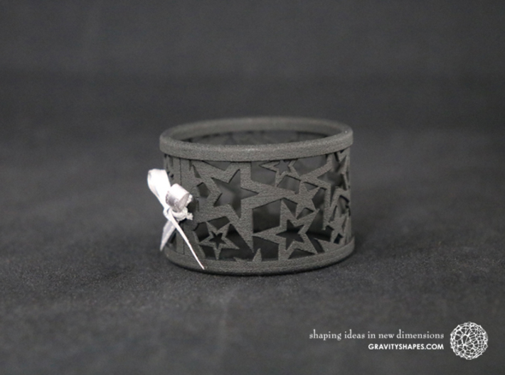 A large Christmas napkin ring with Stars 3d printed The photo shows a print made of black strong and flexible incl. silver lacing.