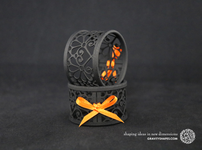 Set of 2 large napkin rings with Mosaic-3b 3d printed The photo shows prints made of black strong and flexible incl. orange lacing.