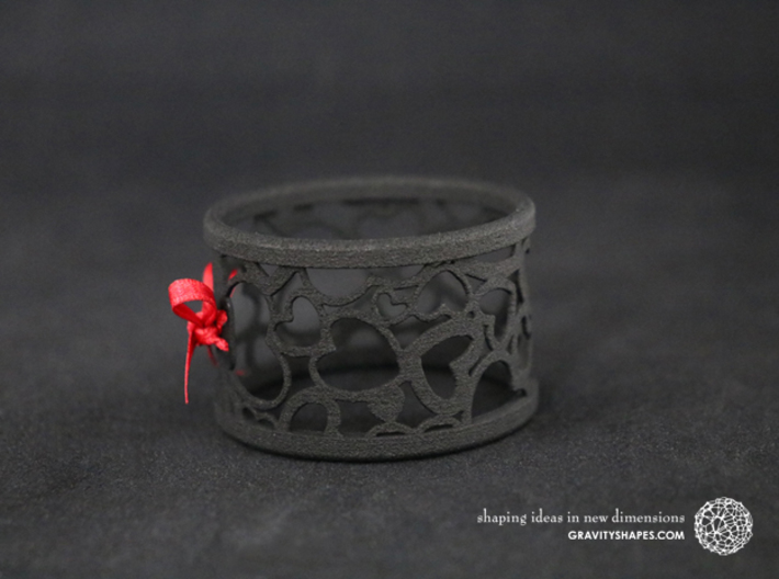 Set of 4 large napkin rings with Hearts 3d printed The photo shows a print made of black strong and flexible incl. red lacing.