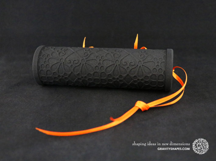 Solid Gift roll XXL-size with Mosaic-3 (14 cm) 3d printed The photo shows a print made of black strong and flexible incl. orange lacing.