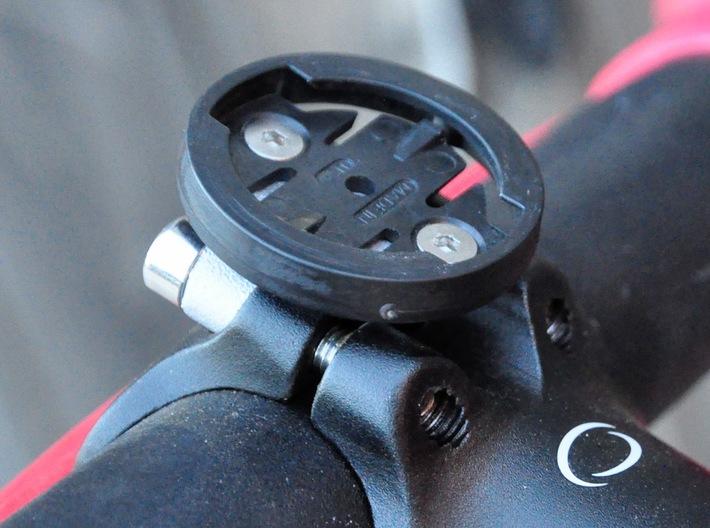 Garmin Stem Top Mount, 20mm Spacing 3d printed Bracket attached to stem. Original stem bolts must be replaced by bolts that are at least 7 mm longer.